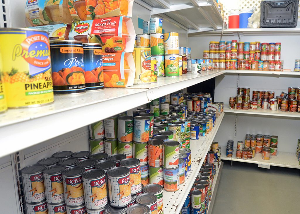 Canned goods on a shelf in a food pantry