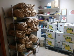 Bulk food being stored at a food pantry.