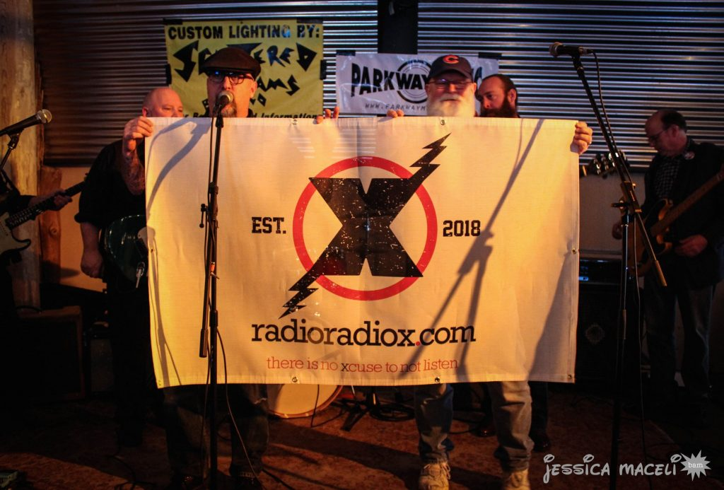 Art Fredette and David Decker holding up a banner. Photo by Jessica Maceli.