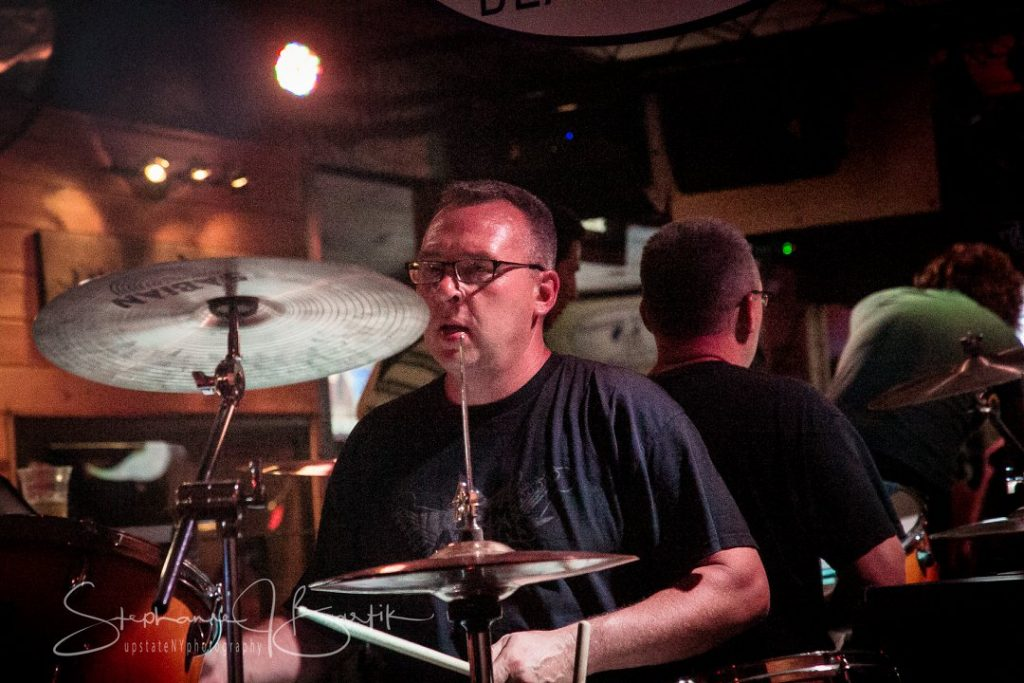 Bob Napierski playing drums. Photo by Stephanie Bartik.