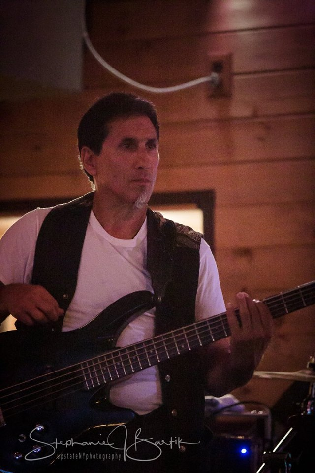 Mike Persico playing bass. Photo by Stephanie Bartik.