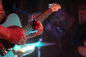 Dan Thomas Cigarette Lighter and Guitar Close Up