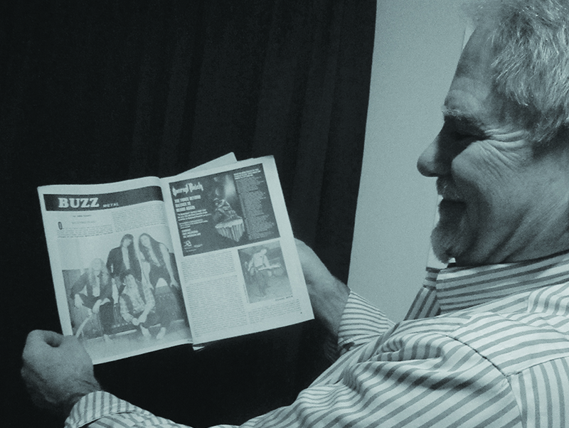 George Guarino with a copy of Buzz Magazine.