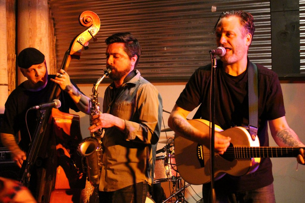 Rocky Velvet's Jay Bird Gorleski (upright bass) and Ian Carlton (acoustic guitar/vocals) with guest saxophonist/vocalist, Justin Birk. Photo by Amy Modesti.