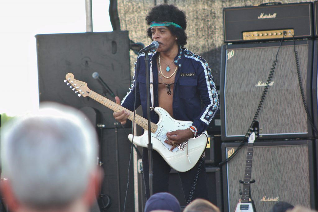 "Jimi Blue from the band, ""Kiss The Sky: the RE- Experience: World's Greatest Tribute to Jimi Hendrix"", performing as the late Jimi Hendrix at Rocking on the River"