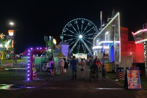 Full view of the Ferris Wheel and other games and amusement rides at the 200th Annual Schaghticoke Fair