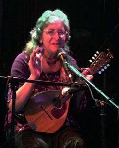 Deb Cavanaugh playing mandolin at the Eden Cafe.